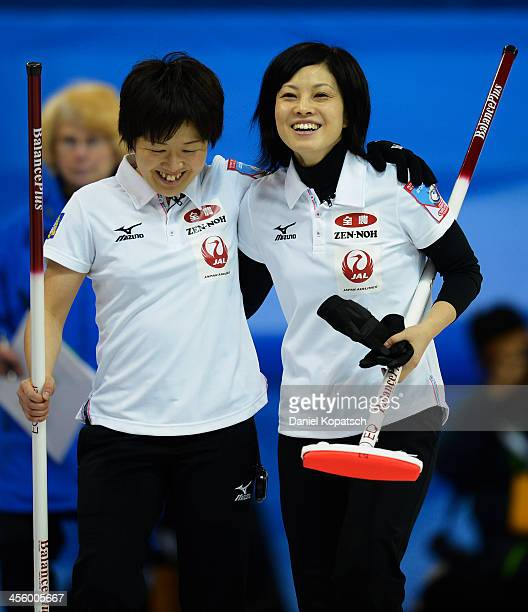 Michiko Tomabechi of Japan and team mate Yumie Funayama celebrate after the Olympic Qualification Tournament match between Germany and Japan on...