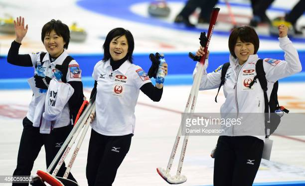 Michiko Tomabechi of Japan and team mates Yumie Funayama and Kaho Onodera celebrate after the Olympic Qualification Tournament match between Japan...