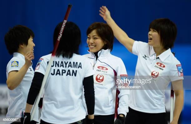 Michiko Tomabechi of Japan and team mates Yumie Funayama Ayumi Ogasawara and Kaho Onodera celebrate after the Olympic Qualification Tournament match...