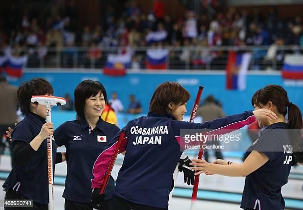 Michiko Tomabechi Yumie Funayama Ayumi Ogasawara and Chinami Yoshida of Japan celebrate the win over Russia during Curling Women's Round Robin match...