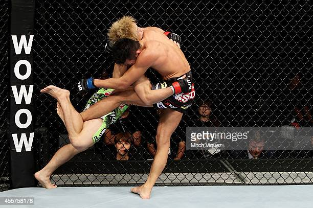 Michinori Tanaka goes for a takedown on Kyung Ho Kang in their bantamweight bout during the UFC Fight Night event inside the Saitama Arena on...