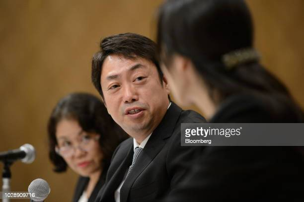 Michio Arikuni president of Suruga Bank Ltd center attends a news conference in Numazu Shizuoka Prefecture Japan on Friday Sept 7 2018 Suruga Bank's...
