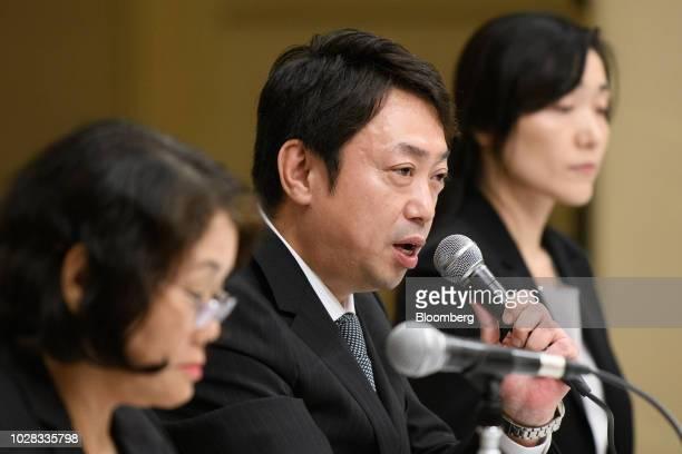 Michio Arikuni president of Suruga Bank Ltd center speaks during a news conference in Numazu Shizuoka Prefecture Japan on Friday Sept 7 2018 Suruga...