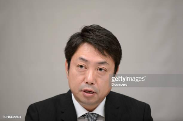 Michio Arikuni president of Suruga Bank Ltd speaks during a news conference in Numazu Shizuoka Prefecture Japan on Friday Sept 7 2018 Suruga Bank's...