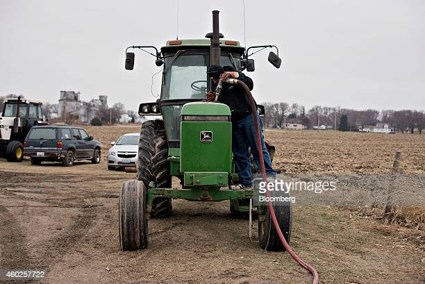 Michlig Energy driver Jake Gould delivers diesel fuel to a John Deere Co tractor in Manlius Illinois US on Wednesday Dec 10 2014 Gasoline supplies...