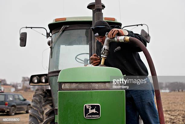 Michlig Energy driver Jake Gould delivers diesel fuel to a John Deere Co tractor in Manlius Illinois US on Wednesday Dec 10 2014 Oil extended losses...