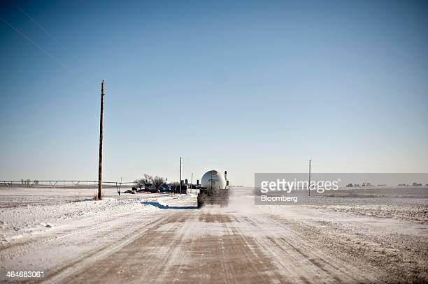A Michlig Energy Ltd delivery truck containing propane travels down a rural road near Princeton Illinois US on Thursday Jan 23 2014 Propane in the...