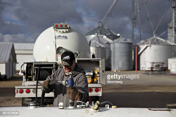 A Michlig Energy worker fills a tank with liquid propane gas during delivery at a home in Wyanet Illinois US on Monday Dec 14 2015 Mild weather will...