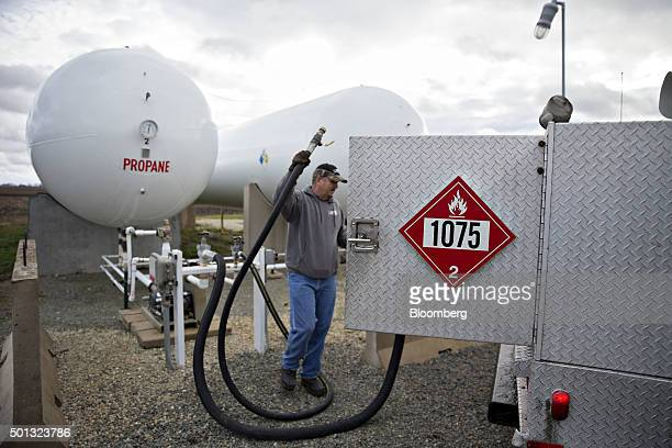 A Michlig Energy worker fills a truck with liquid propane gas from a bulk storage tank in Manlius Illinois US on Monday Dec 14 2015 Mild weather will...