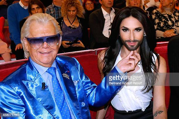 Michou and singer Conchita Wurst attend the 'Vivement Dimanche' French TV Show Held at Pavillon Gabriel on October 29 2014 in Paris France