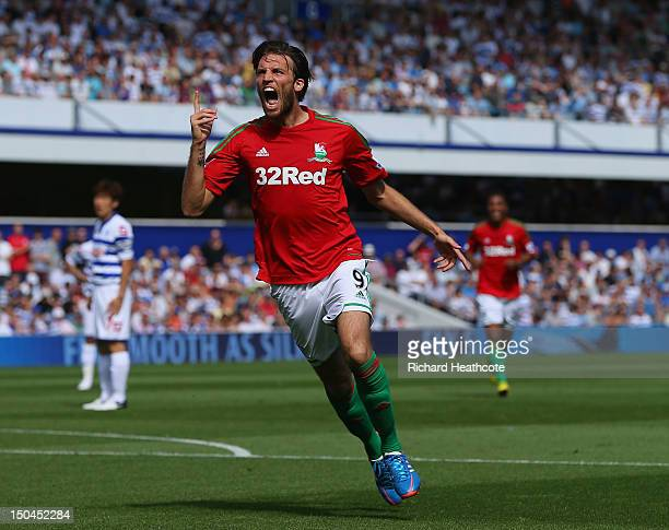 Michu of Swansea celebrates scoring the opening goal during the Barclays Premier League match between Queens Park Rangers and Swansea City at Loftus...