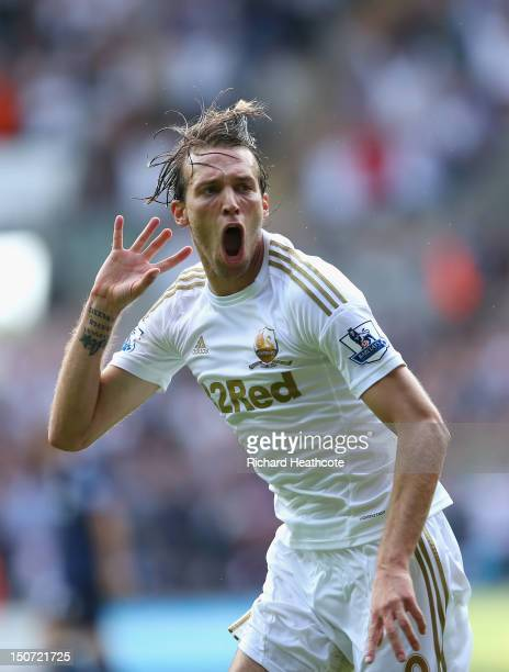 Michu of Swansea celebrates scoring the second goal during the Barclays Premier League match between Swansea City and West Ham United at the Liberty...