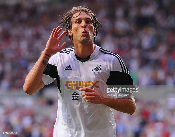 Michu of Swansea celebrates scoring to make it 10 during the UEFA Europa League third round qualifying first leg match between Swansea City and Malmo...
