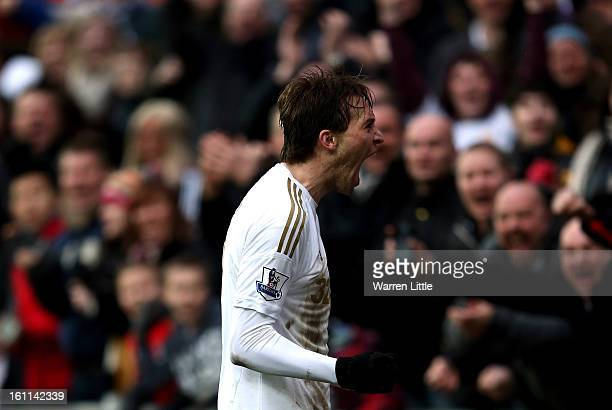 Michu of Swansea City celebrates scoring the fourth goal during the Premier League match between Swansea City and Queens Park Rangers at Liberty...