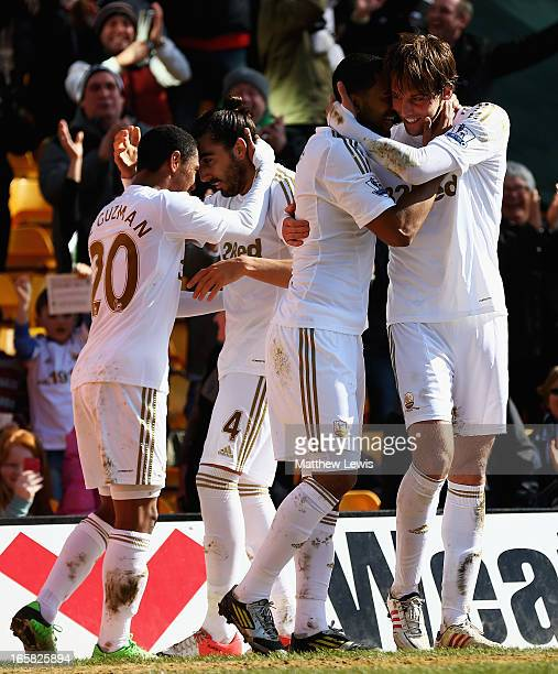 Michu of Swansea City is congratulated on his goal during the Barclays Premier League match between Norwich City and Swansea City at Carrow Road on...