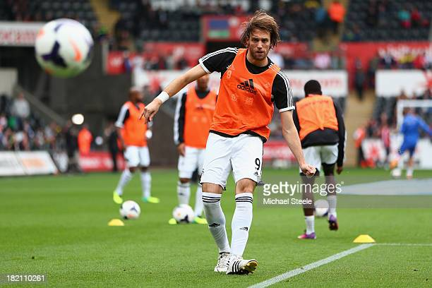 Michu of Swansea City practises his shooting ahead of the Barclays Premier League match between Swansea City and Arsenal at the Liberty Stadium on...