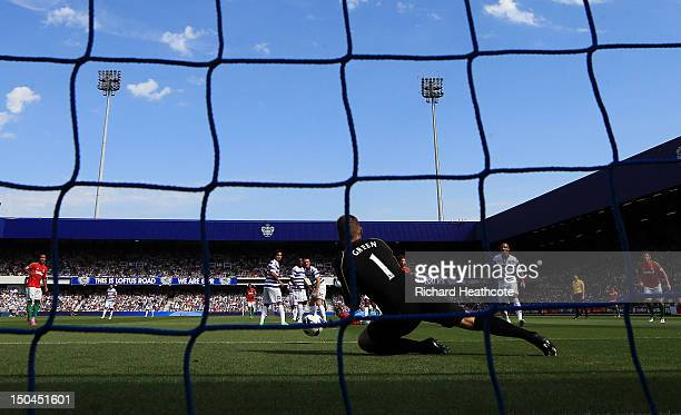 Michu of Swansea scores the opening goal past Robert Green of QPR during the Barclays Premier League match between Queens Park Rangers and Swansea...