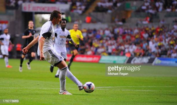 Michu of Swansea scores to make it 1-0 during the UEFA Europa League third round qualifying first leg match between Swansea City and Malmo at the...