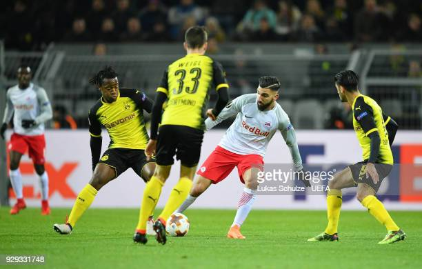 Michy Basthuayi of Borussia Dortmund and Munas Dabbur of Red Bull Salzburg battle for the ball during UEFA Europa League Round of 16 match between...