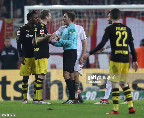 Michy Batshuayi and Andr Schrrle of Dortmund discuss with referee Benjamin Brand after the second goal was disallowed following a video replay during...