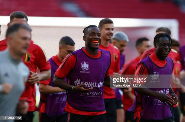 Michy Batshuayi and Jeremy Doku of Belgium react as they warm up during the Belgium Training Session ahead of the UEFA Euro 2020 Group B match...