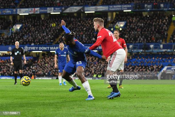 Michy Batshuayi and Luke Shaw during the Premier League match between Chelsea FC and Manchester United at Stamford Bridge on February 17 2020 in...