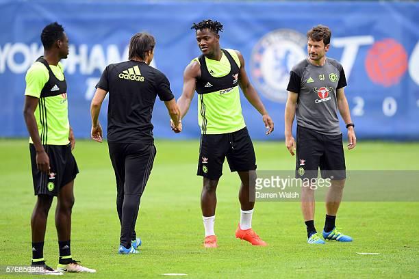 Michy Batshuayi Antonio Conte during a Chelsea training session at Waldarena on July 18 2016 in Velden Austria
