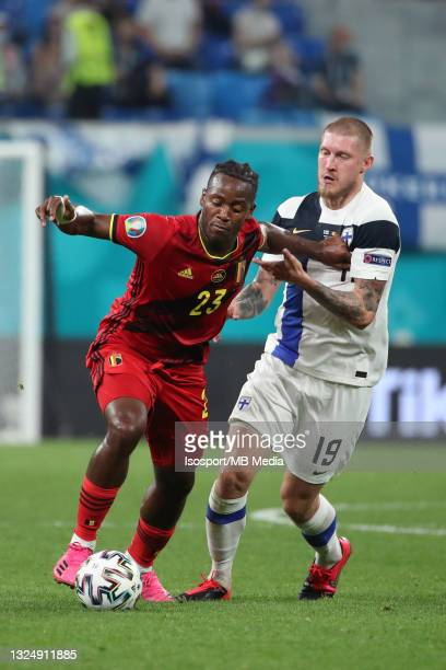 Michy Batshuayi of Belgium battles for the ball with Joni Kauko of Finland during the UEFA Euro 2020 Championship Group B match between Finland and...