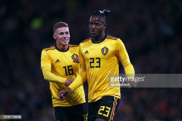 Michy Batshuayi of Belgium celebrates scoring a goal with team mate Thorgan Hazard during the International Friendly match between Scotland and...