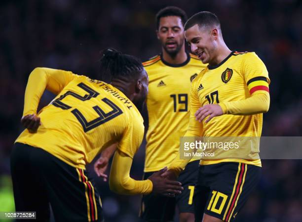 Michy Batshuayi of Belgium celebrates scoring a goal with team mates Eden Hazard and Mousa Dembele during the International Friendly match between...