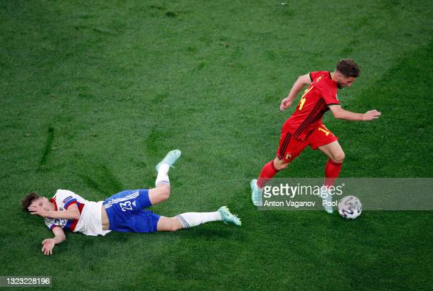 Michy Batshuayi of Belgium evades the tackle from Daler Kuzyaev of Russia during the UEFA Euro 2020 Championship Group B match between Belgium and...