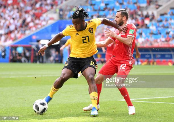 Michy Batshuayi of Belgium is challenged by Ali Maaloul of Tunisia during the 2018 FIFA World Cup Russia group G match between Belgium and Tunisia at...