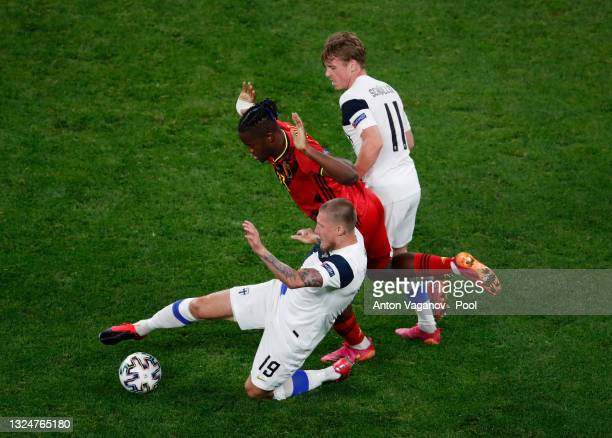 Michy Batshuayi of Belgium is challenged by Joni Kauko and Rasmus Schueller of Finland during the UEFA Euro 2020 Championship Group B match between...