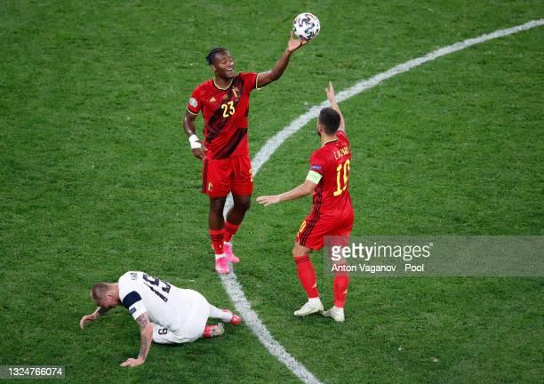 Michy Batshuayi of Belgium passes the ball to teammate Eden Hazard of Belgium during the UEFA Euro 2020 Championship Group B match between Finland...