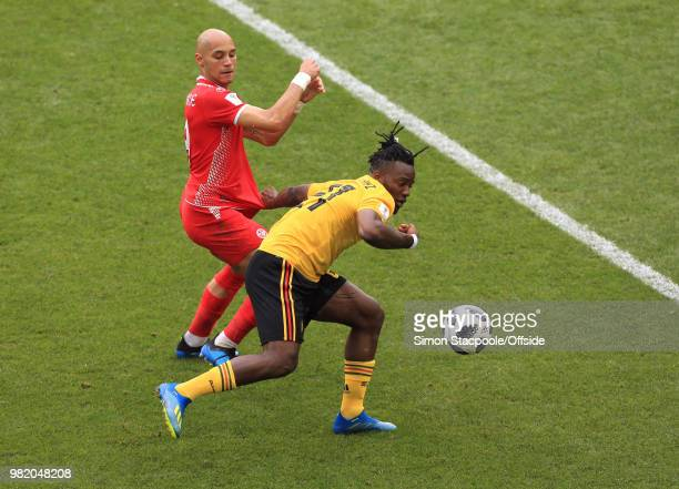 Michy Batshuayi of Belgium shields the ball from Yohan Benalouane of Tunisia during the 2018 FIFA World Cup Russia Group G match between Belgium and...