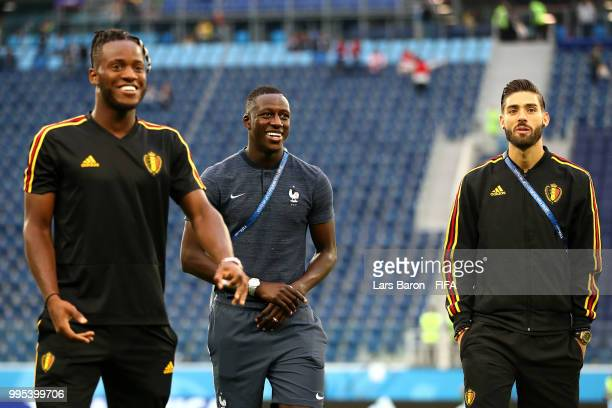Michy Batshuayi of Belgium speaks with Benjamin Mendy of France during a pitch inspection prior to the 2018 FIFA World Cup Russia Semi Final match...