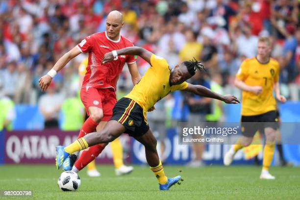 Michy Batshuayi of Belgium tackles Yohan Ben Alouane of Tunisia during the 2018 FIFA World Cup Russia group G match between Belgium and Tunisia at...
