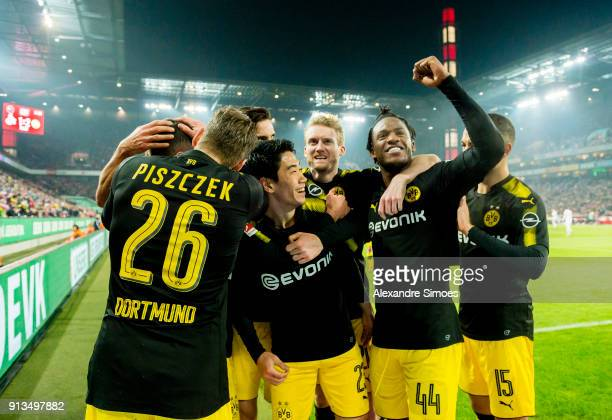 Michy Batshuayi of Borussia Dortmund celebrates scoring the goal to the 12 during the Bundesliga match between 1 FC Koeln and Borussia Dortmund at...