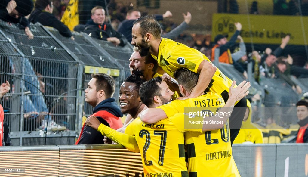 Michy Batshuayi of Borussia Dortmund celebrates scoring the winning goal to the 3:2 with his team mates during the Bundesliga match between Borussia Dortmund and Eintracht Frankfurt at the Signal Iduna Park on March 11, 2018 in Dortmund, Germany.