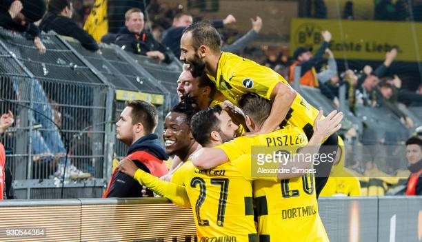 Michy Batshuayi of Borussia Dortmund celebrates scoring the winning goal to the 32 with his team mates during the Bundesliga match between Borussia...