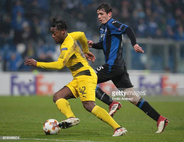 Michy Batshuayi of Borussia Dortmund is challenged by Marten De Roon of Atalanta BC during UEFA Europa League Round of 32 match between Atalanta and...