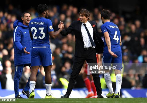 Michy Batshuayi of Chelsea and Antonio Conte Manager of Chelsea embrace after the Premier League match between Chelsea and Watford at Stamford Bridge...