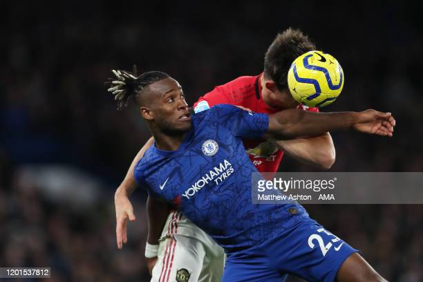 Michy Batshuayi of Chelsea and Harry Maguire of Manchester United during the Premier League match between Chelsea FC and Manchester United at...