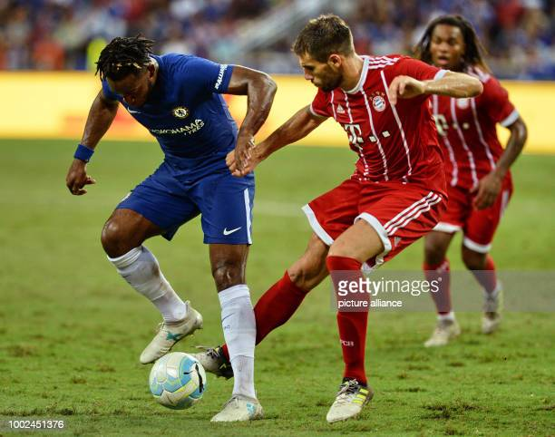 Michy Batshuayi of Chelsea and Javier Martinez of Munich vie for the ball during the International Champions Cup match between FC Bayern Munich and...