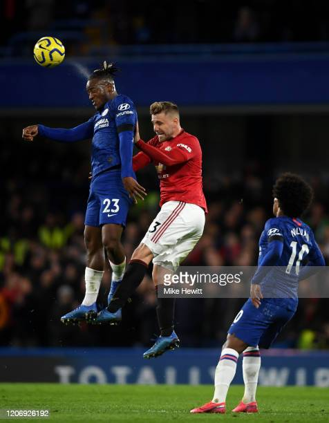 Michy Batshuayi of Chelsea and Luke Shaw of Manchester United during the Premier League match between Chelsea FC and Manchester United at Stamford...