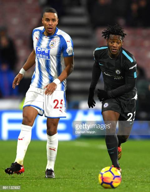 Michy Batshuayi of Chelsea and Mathias Jorgensen of Huddersfield Town in action during the Premier League match between Huddersfield Town and Chelsea...