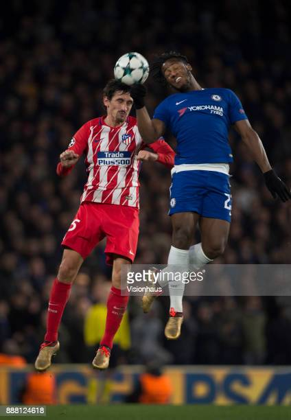 Michy Batshuayi of Chelsea and Stefan Savic of Atletico Madrid in action during the UEFA Champions League group C match between Chelsea FC and...