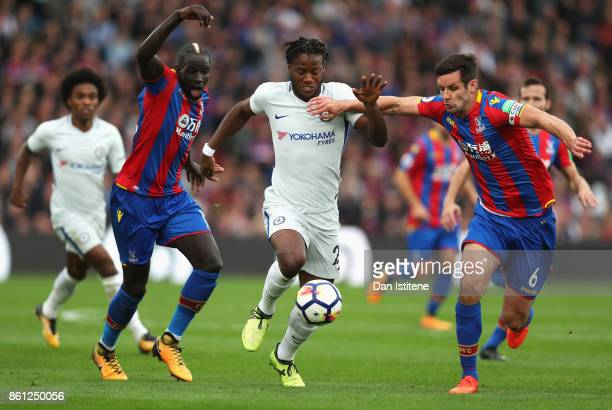 Michy Batshuayi of Chelsea battle for possession with Mamadou Sakho of Crystal Palace and Scott Dann of Crystal Palace during the Premier League...
