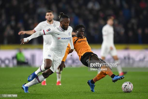 Michy Batshuayi of Chelsea battles for possession with Leonardo Da Silva Lopes of Hull City during the FA Cup Fourth Round match between Hull City FC...