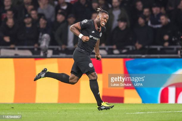 Michy Batshuayi of Chelsea celebrates his team's first goal during the UEFA Champions League group H match between AFC Ajax and Chelsea FC at...